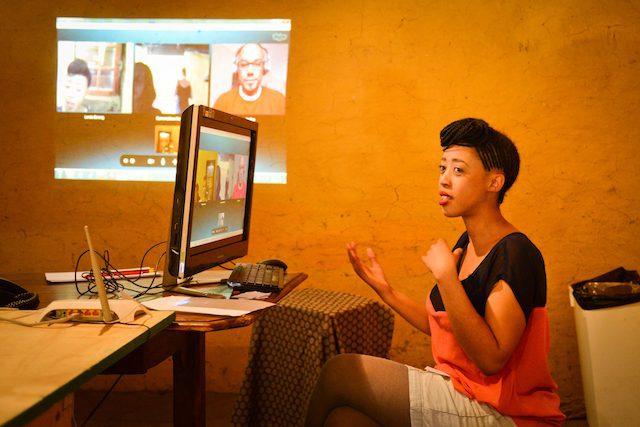 Conversations at Morija #1, 2013. Lerato Bereng, curator, in a Skype conversation with Kojo Baffoe, poet, writer and then-editor of Destiny Man magazine. Photo: Zachary Rosen, Ba Re e Ne Re Literature Festival