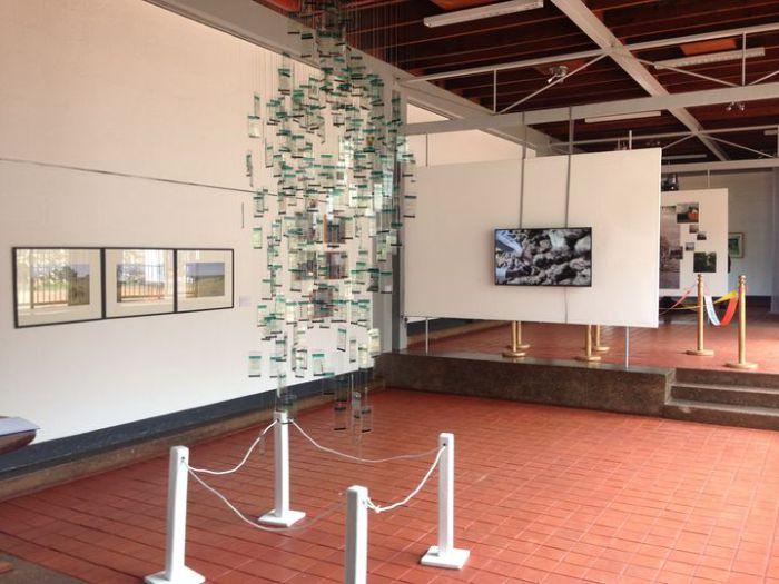 Artworks by Emma Wolukau-Wanambwa: Paradise, 2012, photography, Immy Mali: Virtually Mine, 2016, installation, Syowia Kyambi: Rose's Relocation, 2015, digital collages, and Nástio Mosquito: 3 Continents, 2010, video. Photo: Peters-Klaphake